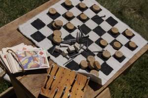 Checkers, cards and a peg solitaire board with nails helped to pass the soldiers' time